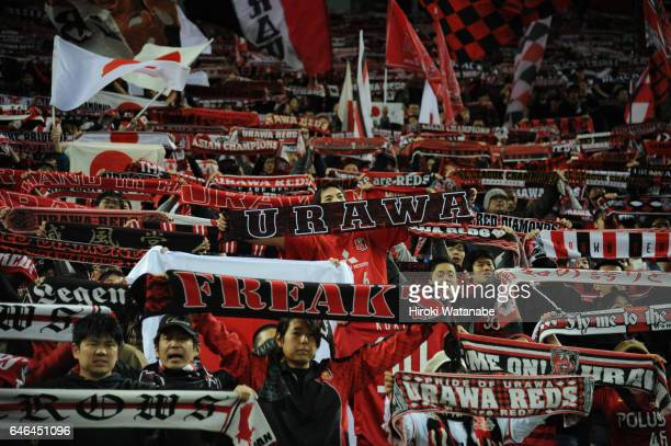 Fans of Urawa Red Diamonds cheer after the AFC Champions League match Group F match between Urawa Red Diamonds and FC Seoul at Saitama Stadium on...