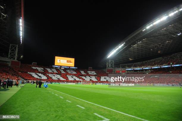 Fans of Urawa Red Diamonds cheer prior to the AFC Champions League semi final second leg match between Urawa Red Diamonds and Shanghai SIPG at...