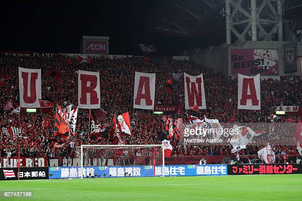 Fans of Urawa Red Diamonds holding up banners during the JLeague Championship Final second leg match between Urawa Red Diamonds and Kashima Antlers...