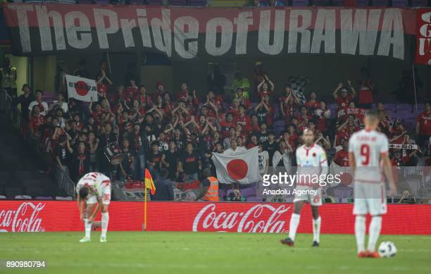 Fans of Urawa Red Diamonds support their team during 2017 FIFA Club World Cup match between Wydad Casablanca and Urawa Red Diamonds at the Hazza Bin...