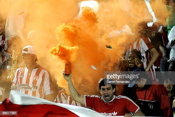 Fans of Uruguay's River Plate cheer their team during their semifinal round match of the 2009 Copa Sudamericana at the Centenario Stadium on November...