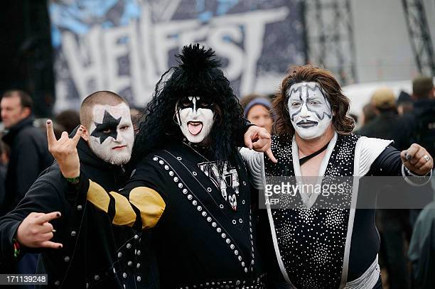 Fans of US rock band Kiss pose during the Hellfest Heavy Music Festival on June 22 2013 in Clisson western France AFP PHOTO JEANSEBASTIEN EVRARD