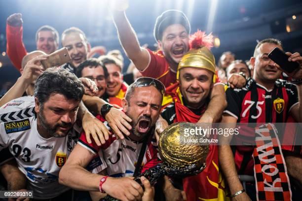 Fans of Vardar celebrate with the trophy after winning the VELUX EHF FINAL4 Final match between Paris SaintGermain Handball and HC Vardar at Lanxess...