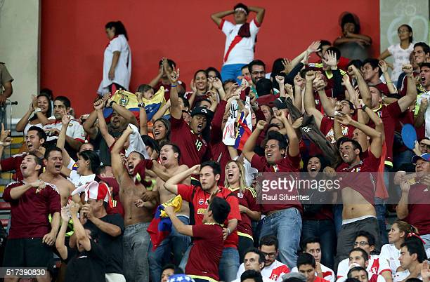 Fans of Venezuela cheer for their team during a match between Peru and Venezuela as part of FIFA 2018 World Cup Qualifiers at Nacional Stadium on...