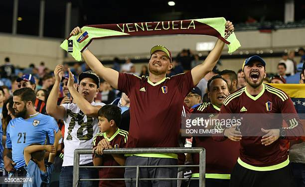 Fans of Venezuela cheer for their team during the Copa America Centenario football match against Uruguay in Philadelphia Pennsylvania United States...