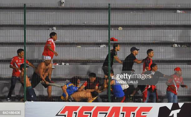 Fans of Veracruz fight against fans of Tigres during their Mexican Clausura 2017 Tournament football match at Luis Pirata Fuente stadium on February...
