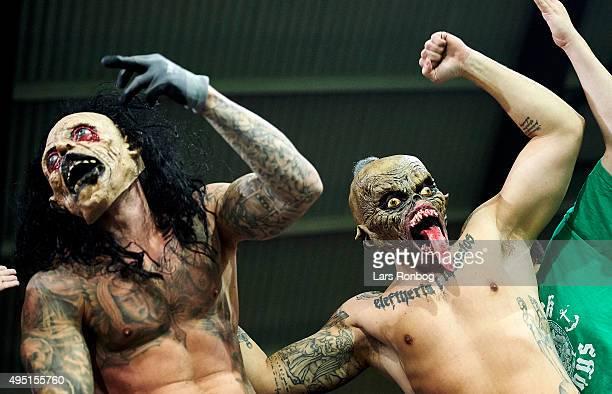 Fans of Viborg FF celebrate with Halloween masks after the Danish Alka Superliga match between FC Midtjylland and Viborg FF at MCH Arena on October...
