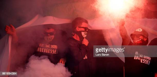Fans of Wolfsburg are seen prior to the Bundesliga match between Bayer 04 Leverkusen and VfL Wolfsburg at BayArena on October 15 2017 in Leverkusen...