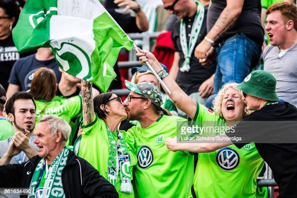 Fans of Wolfsburg celebrate a goal with a kiss during the Bundesliga match between Bayer 04 Leverkusen and VfL Wolfsburg at BayArena on October 15...