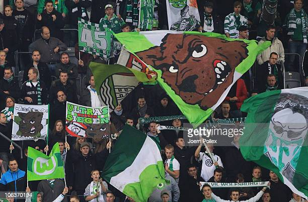 Fans of Wolfsburg celebrate after the Bundesliga match between VfL Wolfsburg and VfB Stuttgart at Volkswagen Arena on October 30 2010 in Wolfsburg...