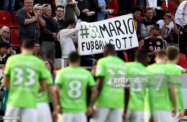 Fans of Wolfsburg hold a banner for Mario Gomez during the Bundesliga match between Bayer 04 Leverkusen and VfL Wolfsburg at BayArena on April 2 2017...