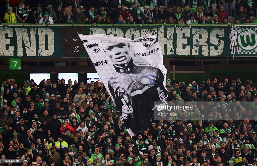 Fans of Wolfsburg wave a flag showing former player Junior Malanda during the Bundesliga match between VfL Wolfsburg and FC Bayern Muenchen at Volkswagen Arena on January 30, 2015 in Wolfsburg, Germany. Malanda had died in a car accident on January 10.