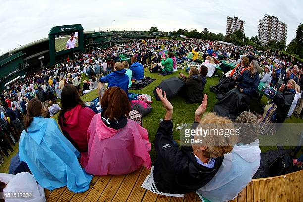 Fans on Murray mound applaud match point as they watch the Andy Murray against Kevin Anderson game on the big screen on day seven of the Wimbledon...