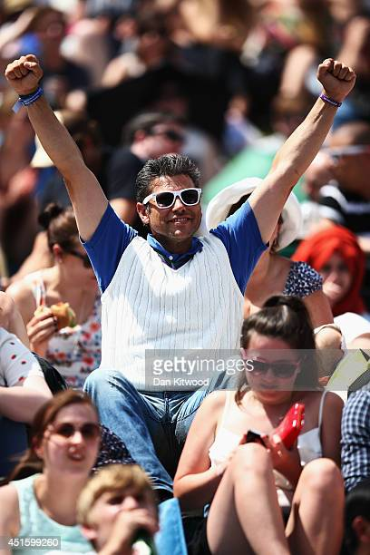 Fans on Murray mound as they watch the Andy Murray against Grigor Dimitrov match on day nine the Wimbledon Lawn Tennis Championships at the All...