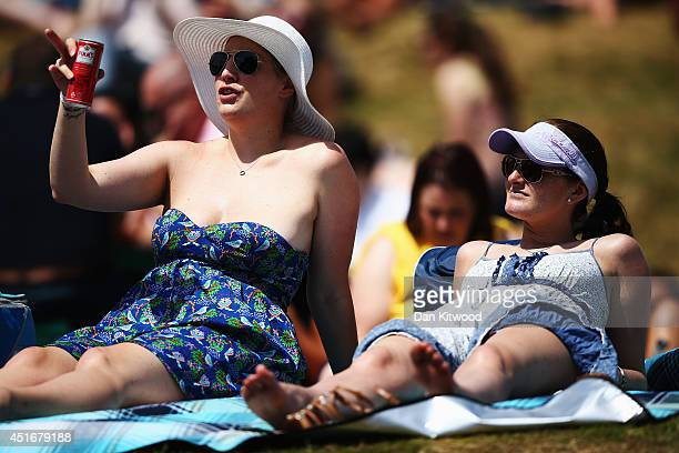 Fans on Murray Mound drinking cans of pimms as they soak up the sun on day eleven of the Wimbledon Lawn Tennis Championships at the All England Lawn...