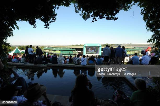 Fans on Murray Mount watch Andy Murray play USA's Robert Kendrick during the 2009 Wimbledon Championships at the All England Lawn Tennis and Croquet...