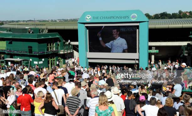 Fans on Murray Mount watch him in action against USA's Robert Kendrick during the 2009 Wimbledon Championships at the All England Lawn Tennis and...