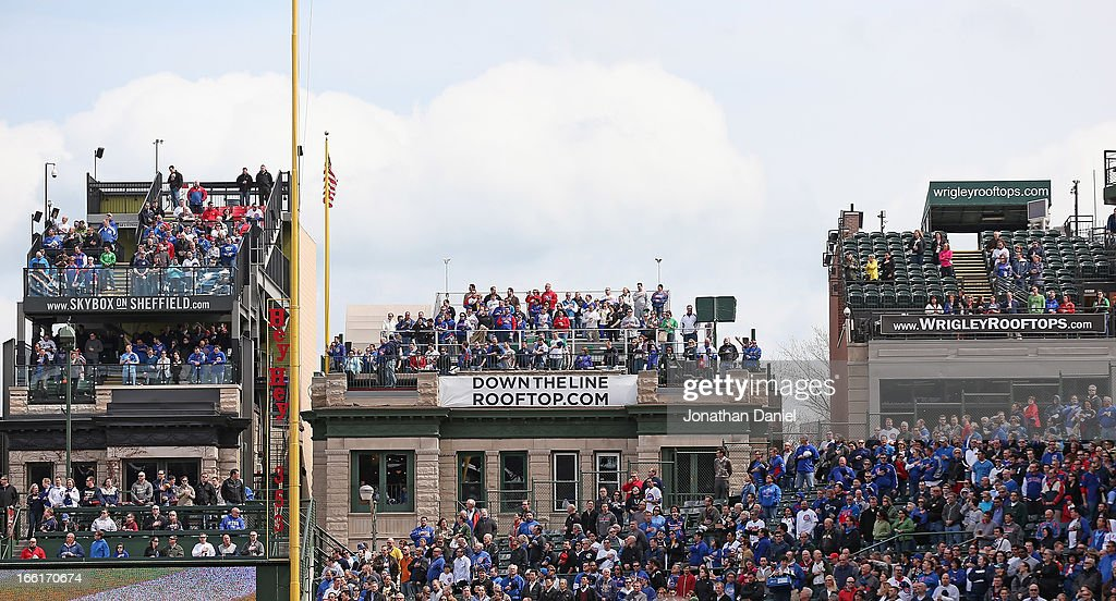 Fans on rooftops overlooking Wrigley Field watch the Opening Day action between the Chicago Cubs and the Milwaukee Brewers at Wrigley Field on April 8, 2013 in Chicago, Illinois. The Brewers defeated the Cubs 7-4.