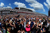 Fans on the infield take in prerace festivities for the NASCAR Sprint Cup Series 57th Annual Daytona 500 at Daytona International Speedway on...