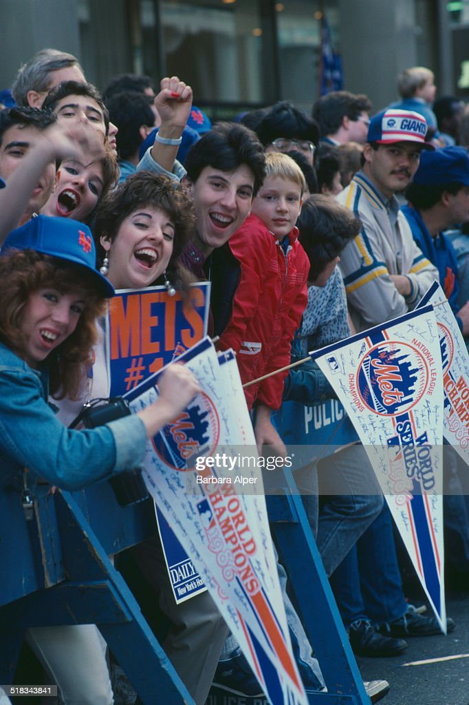 Fans on the route of a ticker tape parade to celebrate the New York Mets winning the World Series New York City USA 28th October 1986