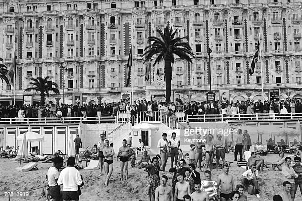 Fans on the seafront outside the Carlton Hotel waiting for film stars to arrive during the Cannes Film Festival 3rd May 1959