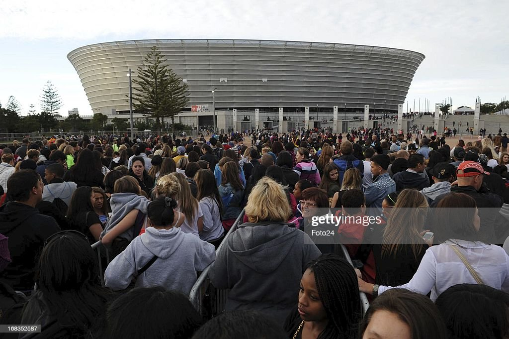 Fans outside the Cape Town Stadium on May 8 in Cape Town South Africa On his 'Believe' tour Justin Bieber performed in Cape Town on MAY 8 2013 and...