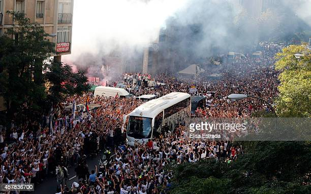Fans outside the ground welcome the Real Madrid team as they arrive by bus prior to the the La Liga match between Real Madrid CF and FC Barcelona at...