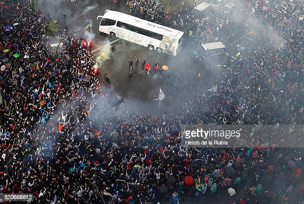 Fans outside the ground welcome the Real Madrid team as they arrive by bus prior to the UEFA Champions League quarter final second leg match between...