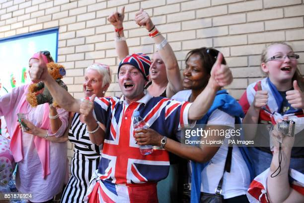 Fans outside the Lindo Wing of St Mary's Hospital in Paddington London celebrate the announcement of the birth of the royal baby