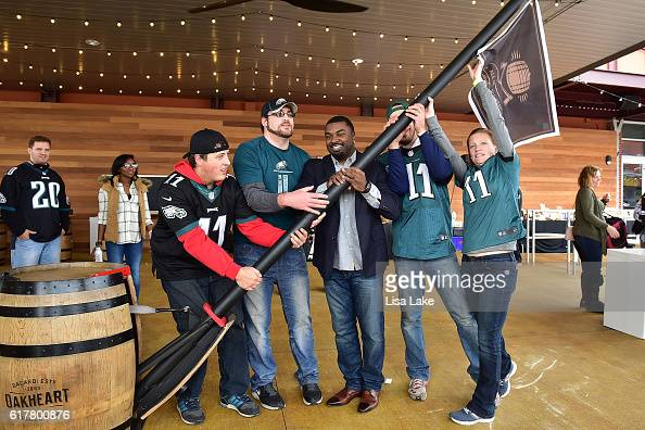 Fans participate in raising Oakheart rum flag with former NFL Philadelphia Eagles player Brian Westbrook during the Oakheart Genuine Spiced Rum Event...