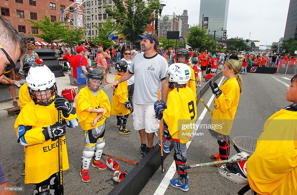 Fans participate in the 2013 NHL Draft Fan Fest at Prudential Center on June 30, 2013 in Newark, New Jersey.