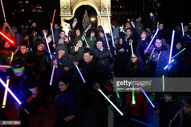 Fans participate in the Star Wars Lightsaber Battle 'The Light Battle Tour' New York City at Washington Square Park on December 18 2015 in New York...