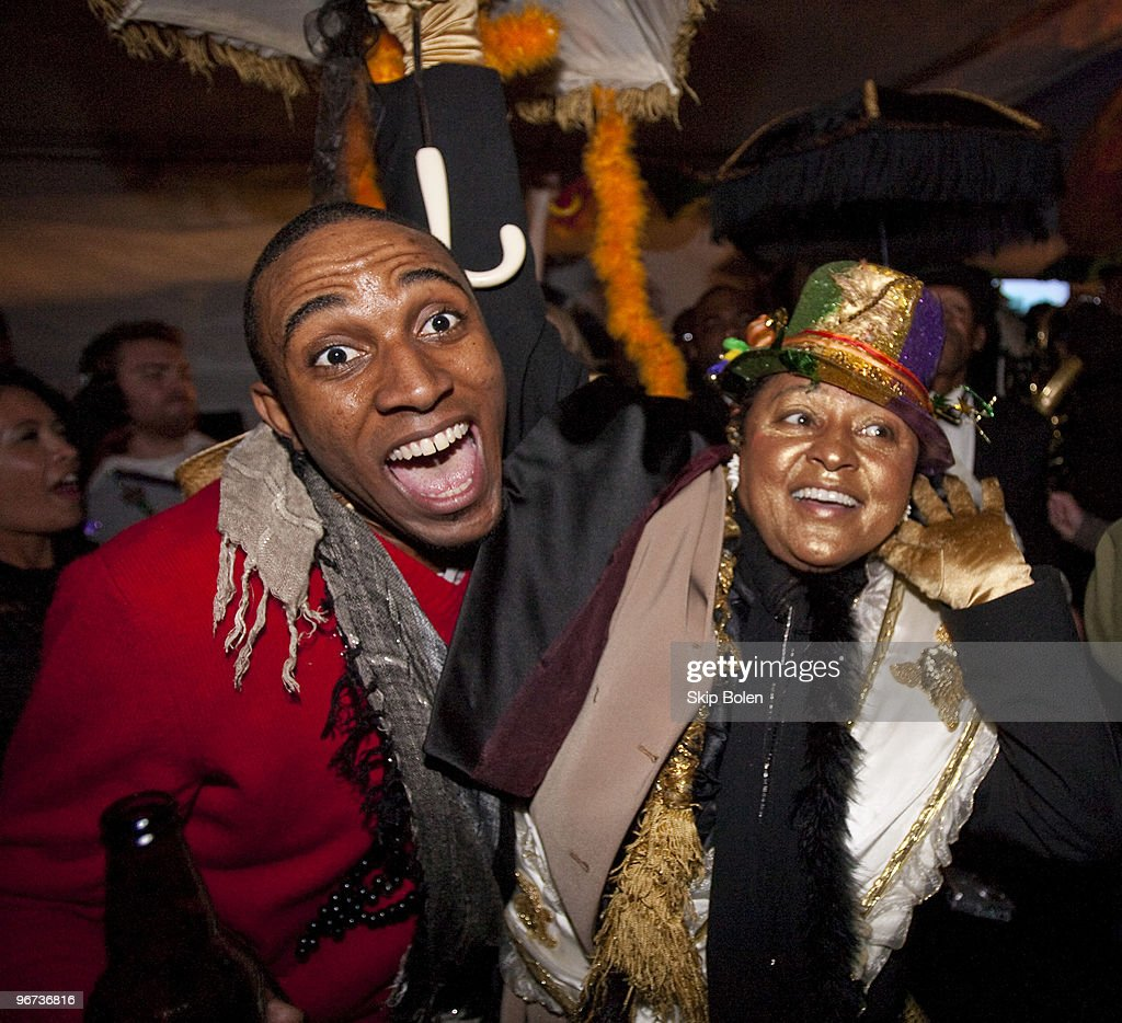 Fans party and dance to Big Sam's Funky Nation as they parade and second line at Maxim's Mega Mansion at Buckner Mansion on February 15, 2010 in New Orleans, Louisiana.