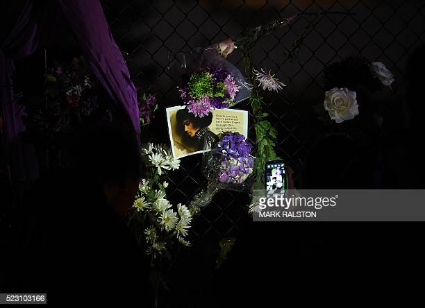 Fans pay their respects outside the Paisley Park residential compound of music legend Prince in Minneapolis Minnesota on April 21 2016 Emergency...