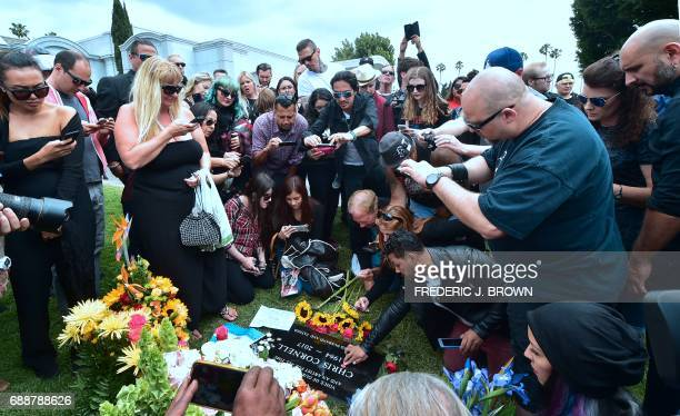 Fans pay their respects to Soundgarden frontman Chris Cornell at his grave following a funeral service on May 26 2017 at the Hollywood Forever...