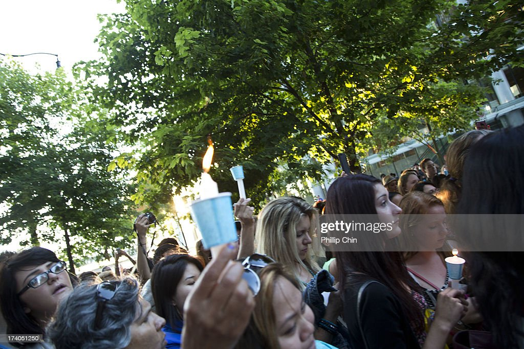 Fans pay Tribute at the Candle Light Vigil for Cory Monteith at the Fairmont Pacific Rim on July 19, 2013 in Vancouver, Canada.