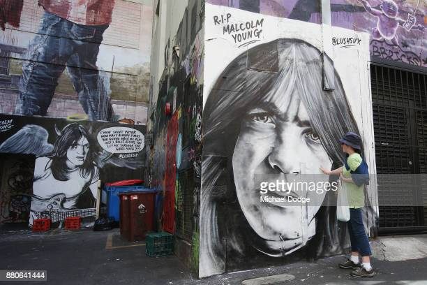 Fans pay tribute to Malcolm Young on ACDC Lane on November 28 2017 in Melbourne Australia The funeral service for AC/DC guitarist and cofounder...