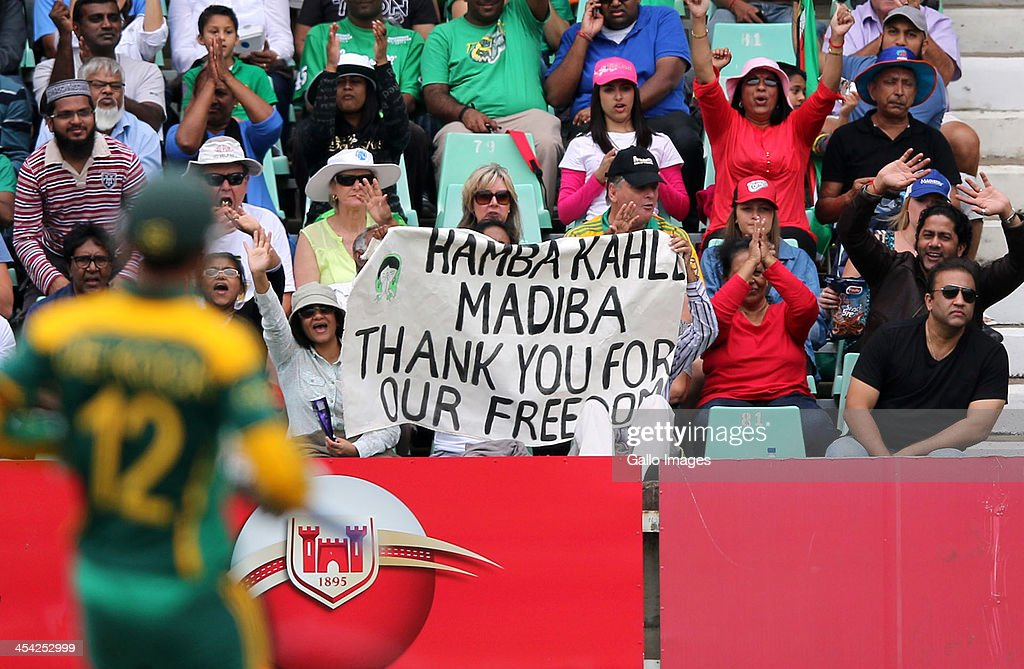 Fans pay tribute to Nelson Mandela during the 2nd Momentum ODI match between South Africa and India at Sahara Stadium Kingsmead on December 08, 2013 in Durban, South Africa.
