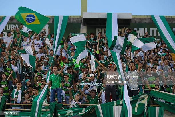 Fans pay tribute to the players of Brazilian team Chapecoense Real at the club's Arena Conda stadium in Chapeco in the southern Brazilian state of...