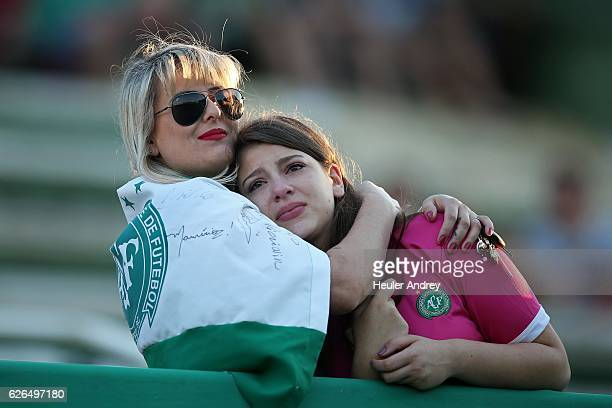Fans pay tribute to the players of Brazilian team Chapecoense Real who were killed in a plane accident in the Colombian mountains at the club's Arena...