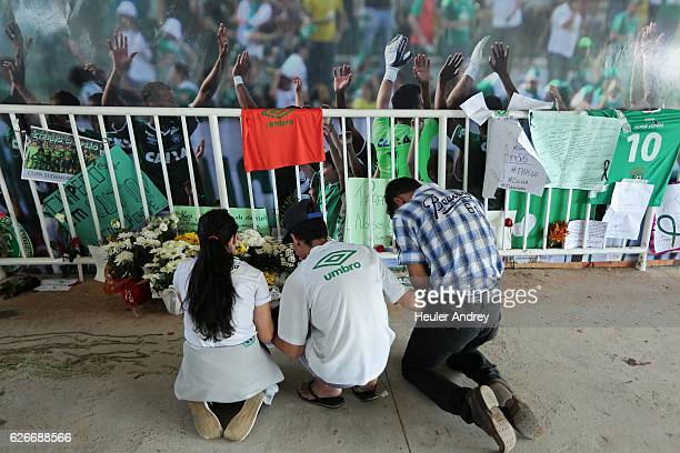 Fans pays tribute to the players of Brazilian team Chapecoense Real who were killed in a plane accident in the Colombian mountains at the club's...