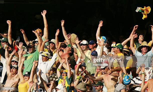 Fans perform a 'Mexican Wave' during day one of the first Ashes Test Match between Australia and England at The Gabba on November 23 2006 in Brisbane...