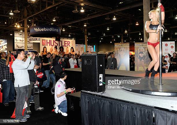 Fans photograph a dancer at the FyreTV booth at the 2011 AVN Adult Entertainment Expo at the Sands Expo and Convention Center January 8 2011 in Las...
