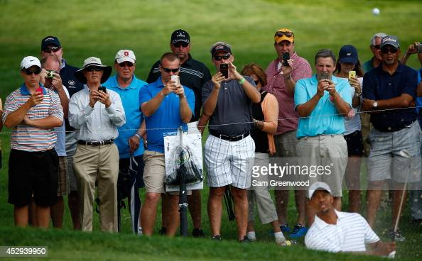Fans photograph Tiger Woods on their cell phones during a practice round for the World Golf ChampionshipsBridgestone Invitational at Firestone...