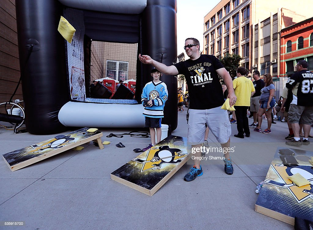 Fans play cornhole prior to Game One of the 2016 NHL Stanley Cup Final between the San Jose Sharks and the Pittsburgh Penguins at Consol Energy Center on May 30, 2016 in Pittsburgh, Pennsylvania.