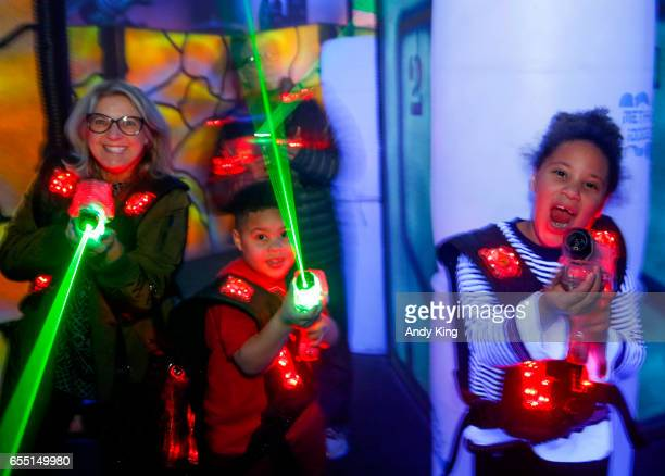Fans play Laser Tag at the Grand Opening of Bowlero Eden Prairie on March 18 2017 in Eden Prairie Minnesota