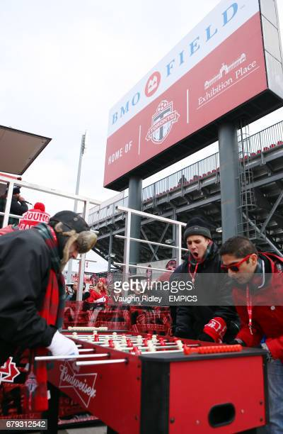 Fans play table football prior to the match