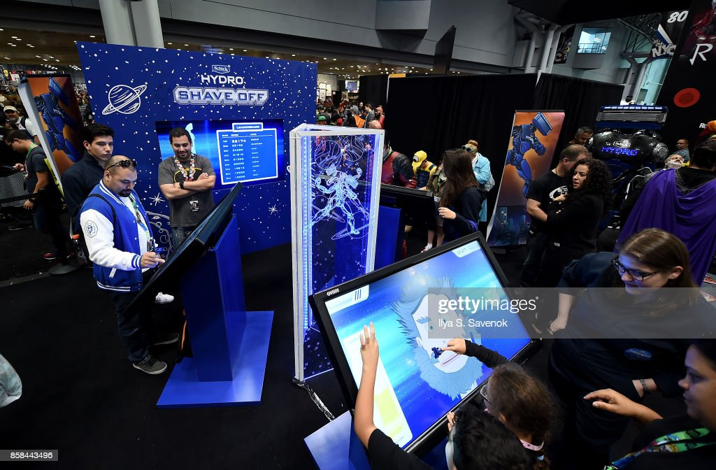 Fans play the 'Schick Shave Off' video game with Schick Hydro At New York Comic-Con 2017 on October 6, 2017 in New York City.