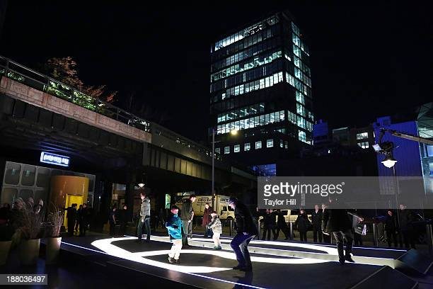 Fans play video games on a giant screen installation at the PlayStation 4 North American official launch event presented by Sony Entertainment...