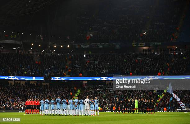 Fans players and officials observe a minutes silence for the victims of the plane crash involving the Brazilian club Chapecoense prior during the...